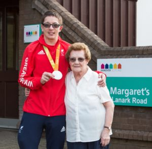 Picture of Paralympic silver medallist Scott Quin, with his Grandmother May Patton, outside St Margaret's Court sheltered housing development.