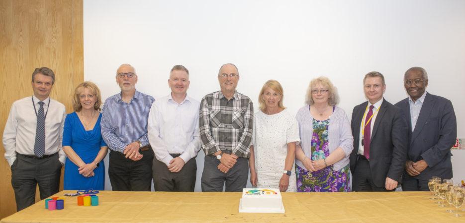 the Hanover board cutting a cake